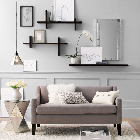 Home Essentials Floating Shelves with Art Wall Mirror Gray Couch Glass Side Table Flowers